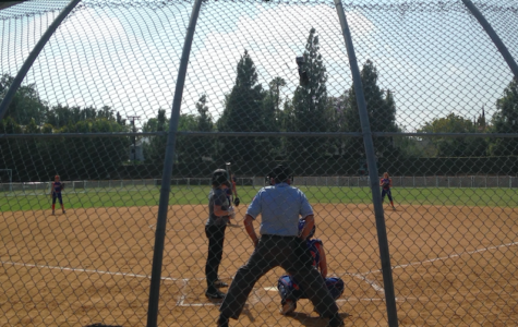 The Archer Softball team playing in their final game of the season. The team competes in the Liberty League.