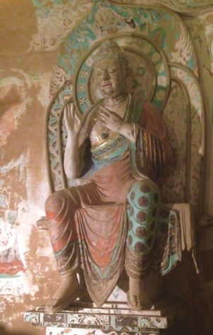Buddha statue in Cave 320. The exhibit runs from May 7 to September 4.