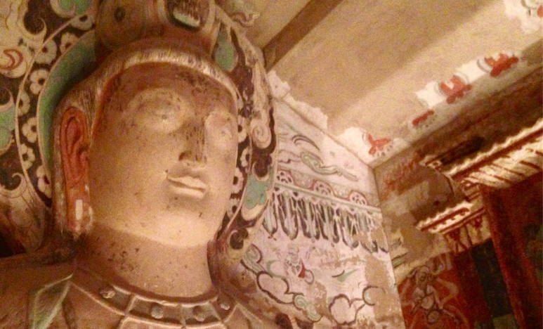 A+large+statue+of+a+buddha+was+replicated+and+placed+in+the+Getty+Center%27s+replica+of+Cave+275.+The+real+cave+is+located+in+the+Mogao+Grottoes+outside+of+Dunhuang%2C+China.+