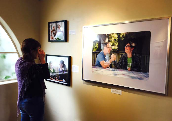 An Archer parent attends senior Shishi Shomloo's opening of her first photo gallery at Archer. Parents, teachers, and students all came to view her work. Photographer: Haley Kerner '16