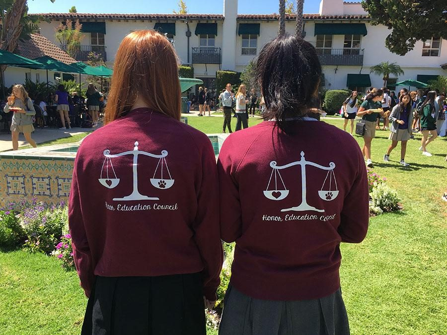 Anna Brodsky '20 and Marine Yamada '17 pose with their Honor Education Council sweatshirts.
