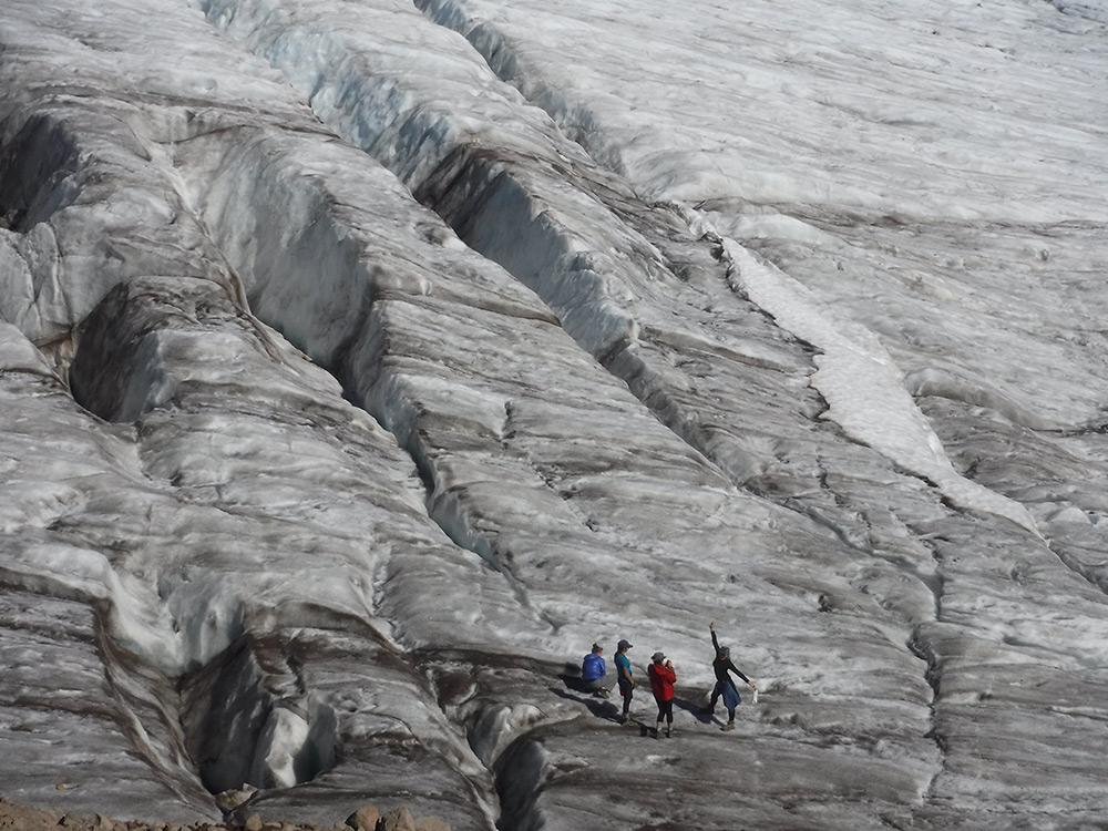 Four Archer juniors pose on top of a glacier during their last Arrow Week. This is the winning photo from the 11th grade photo competition.