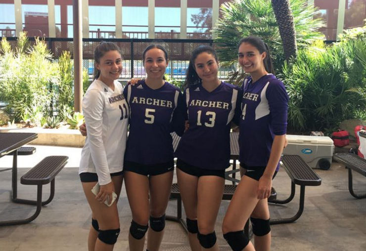 Seniors, Valentina Pianiri, Sophie Smyth, Zoe Pelikan and Clara Gasparetti (from left to right) pose in their volleyball uniforms. All four seniors have played four years of Archer volleyball. Image courtesy of Smyth.