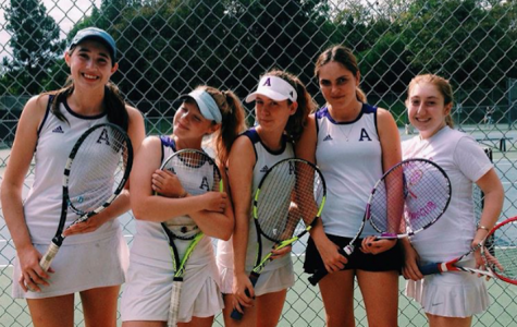 Tennis players, from left to right, Elyse Pollack '18, Liadan Solomon '17, Zoe Woolf '19, Rachel Ferrera '18 and Isabella Simanowitz '18 smile at a match. The team's overall record is  7-4. Photo courtesy of Simanowitz.