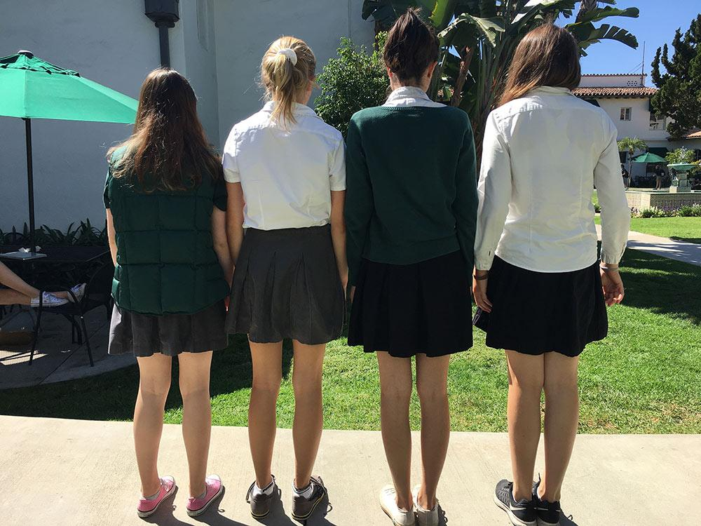 Seniors show off their skirt lengths. Skirt length has been a topic of debate during the school year.