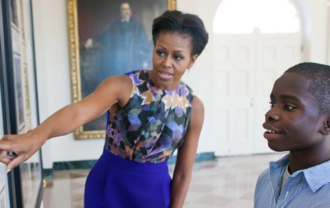 An image of Michelle Obama from the official White House website. The First Lady's friendship with George W. Bush has made headlines after an impromptu hug at the opening of the African American Museum of History and Culture. Image source: <a href='https://www.whitehouse.gov/administration/first-lady-michelle-obama'>The White House</a>.