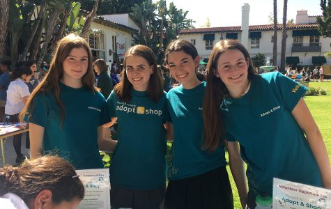 Maren O'Sullivan '18, Sandy Frank '19, Eden Motzkin '19, and Maddie Jacobson '19 pose at their booth for the Found Animals Foundation at the 2016 Community Service Fair. This booth was for the