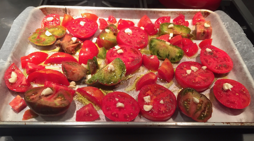 Tomatoes+with+garlic%2C+olive+oil%2C+pepper%2C+and+paprika+roast+in+preparation+for+tomato+soup.+This+can+easily+be+done+a+few+hours+in+advance.+