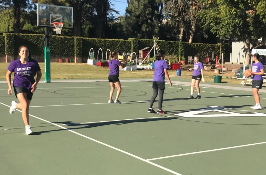 Middle+schoolers+run+and+play+basketball+on+the+Sport+Court+during+fitness+class.+In+addition+to+after+school+sports%2C+the+Court+is+used+for+daily+fitness+classes.