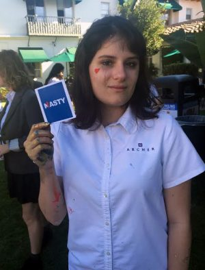 """Elizabeth Zinman '17 shows off her """"Nasty"""" badge in honor of presidential candidate Hillary Clinton."""