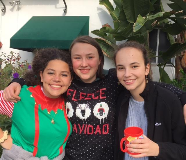 Sophomores+Juliet+Youssef%2C+Grace+Kerner%2C+and+Alexa+Tierney+pose+while+serving+hot+chocolate+to+students.+