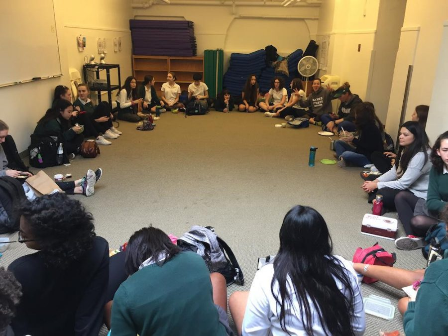Students+and+teachers+gather+in+the+yoga+room+at+lunch+for+the+GSA+meeting.+The+Diversity+Club+also+attended+this+meeting.