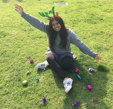 Editor-in-Chief Anika Bhavnani poses with holiday themed decorations. Bhavnani is going into her last semester of her Archer career.