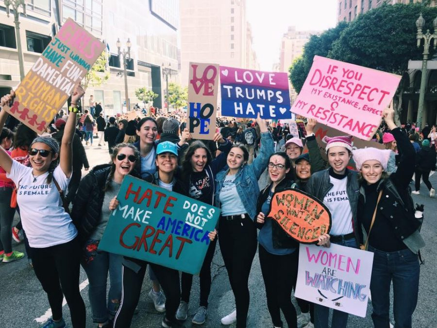 Archer seniors Leyla Namazie, Isabelle Wilson, Clara Gasparetti, Rachel Pike, Carly Feldman, Eloise Rollins-Fife, Liadan Solomon, Audrey Koh, Isabel Adler, Ingrid Sant and junior Gemma Brand-Wolf pose for a photo at the Women's march in Downtown LA. They hand-made all of their posters. Photo Courtesy of Wilson.