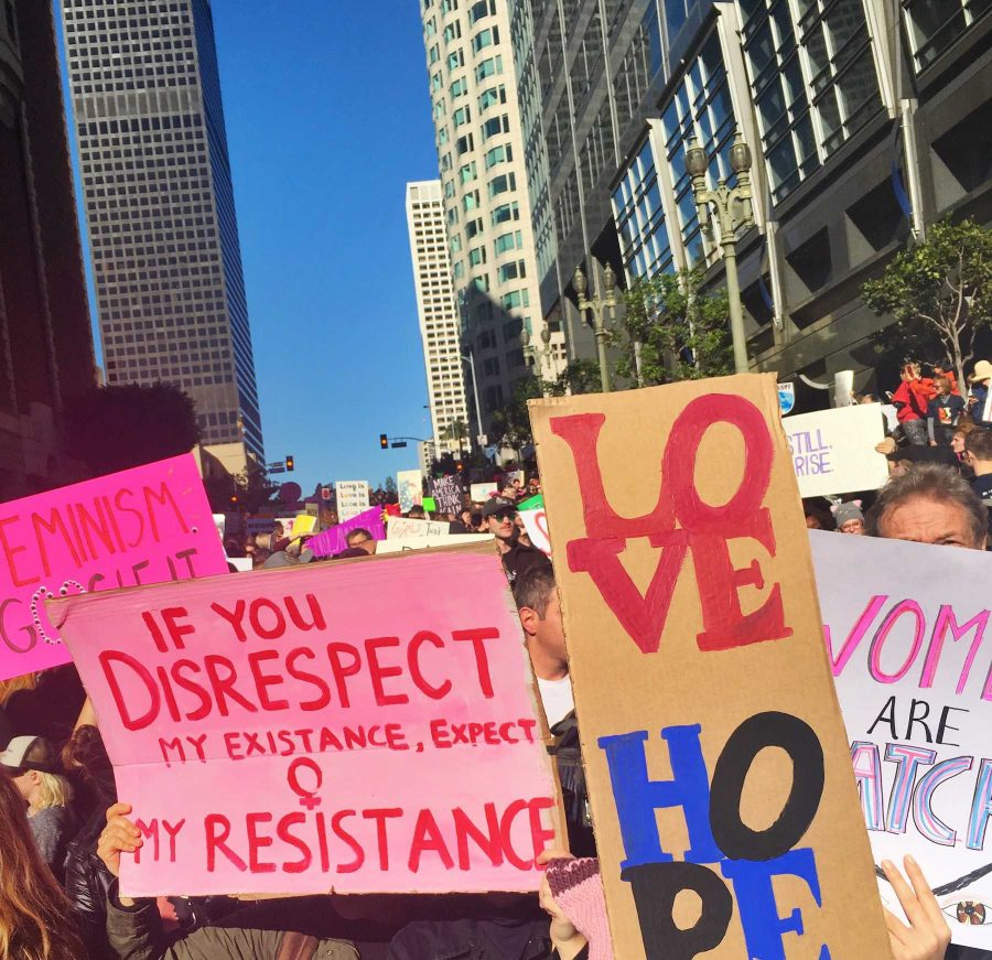 Some of the hundreds of thousands of protest signs at the Los Angeles Women's March are held high by Archer girls. Signs at the march ranged from humorous to somber and touched on a variety of social, economic and environmental justice-related issues.
