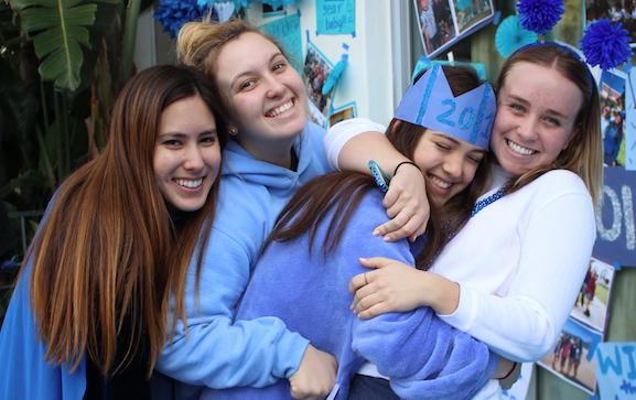 From left to right, seniors Mari Goldberg, Anabelle Robertson, Rachel Erickson and Billie Wakeham cheer for their team. The seniors' slogan was