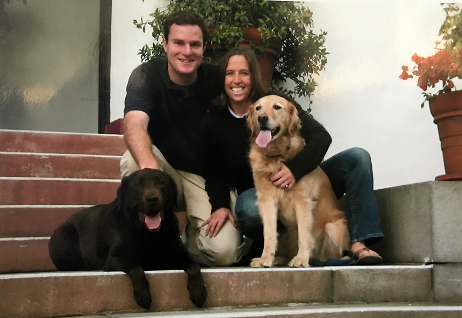 Taken+in+2005%2C+two+years+after+they+moved+to+Los+Angeles+and+before+they+were+married%2C+Jed+Donnel+and+Samantha+Coyne+pose+with+their+two+dogs+on+Archer%27s+front+steps.+They+will+be+leaving+this+summer+after+15+years+at+Archer.+Photo+courtesy+of+Donnel