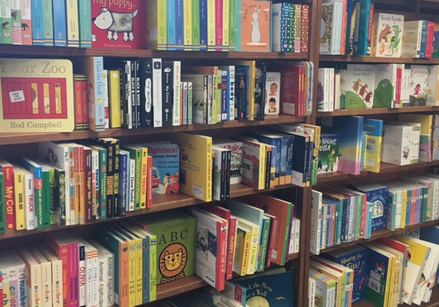 Board+books+are+displayed+on+a+shelf+in+the+front+of+the+store.+Owner+Sharon+Hearn+carefully+curates+each+collection.+%22We+have+such+a+broad+selection+of+titles%2C%22+Hearn+said.+%22I+really+enjoy+picking+out+the+books+that+the+store+sells.%22