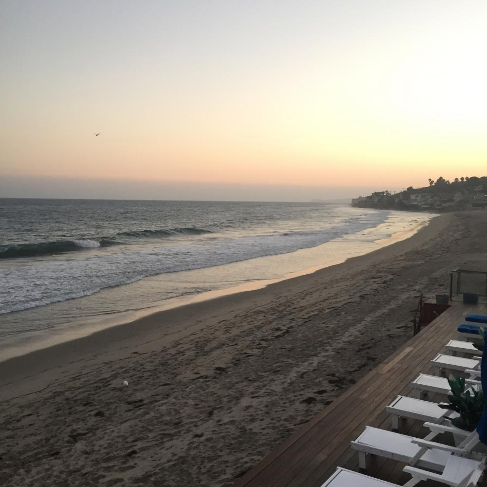 Pictured above is a photograph of a sunset in Malibu. Memorial Day events often involve beach activities.
