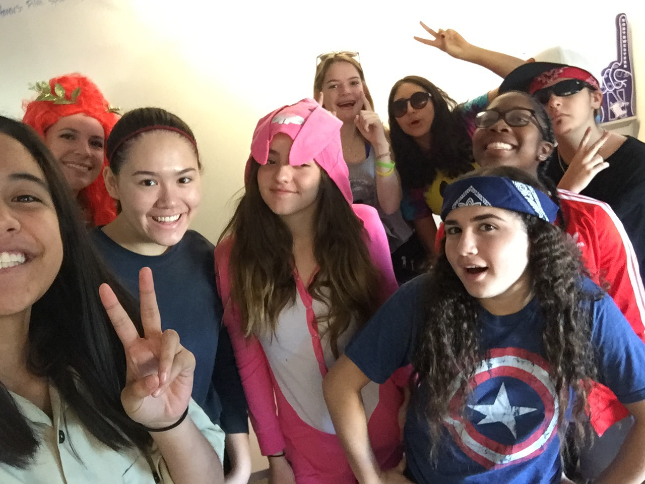 Danielle Roberts, Jenn Babin, Cybele Zhang, Meagan Rowles, Gracie Marx, Jael Ellman, Sophie Evans-Katz, Kamryn Bellamy and Macoy Olhbaum pose during advisory on Halloween in 2015. Babin has been Class Dean of 2018 since 2014, but will be taking on the role of Dean of Students in the fall. Image courtesy of Cybele Zhang.