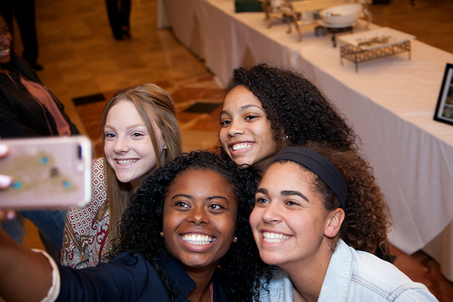 Coach Amelia Mathis takes a picture with Rachel Pike '17, Liadan Solomon '17 and Alyssa Downer '17. The sports banquet celebrates athletes from fall, winter and spring sports.
