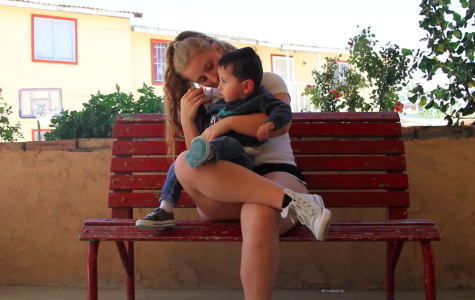 Gwen Strasberg '19 holds a child from the orphanage in her arms. Photo courtesy of Strasberg.