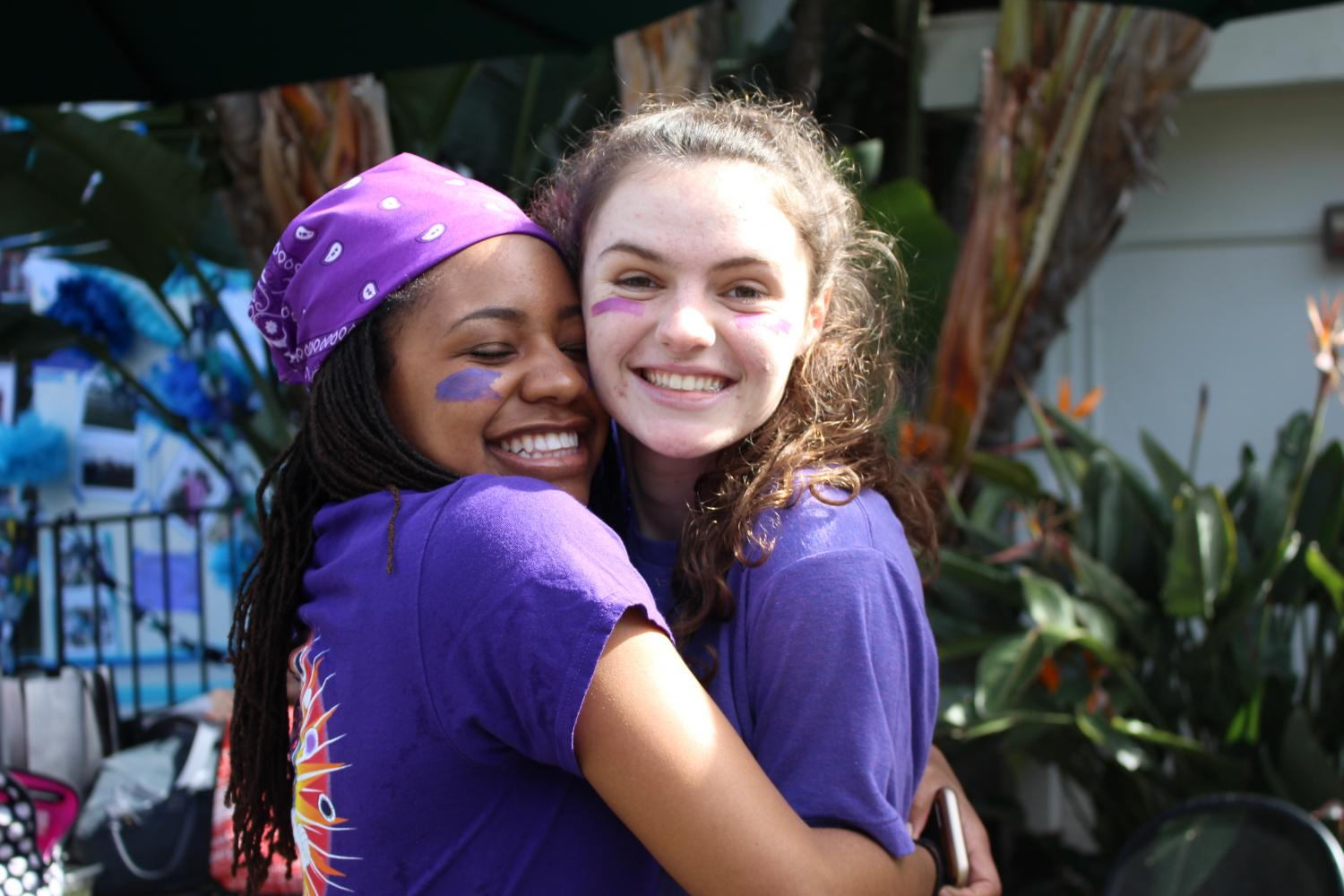 Cydney Davis '18 and Rachael Boehm '18 embrace during Color Wars 2017. The 2017-2018 school year's theme is love.