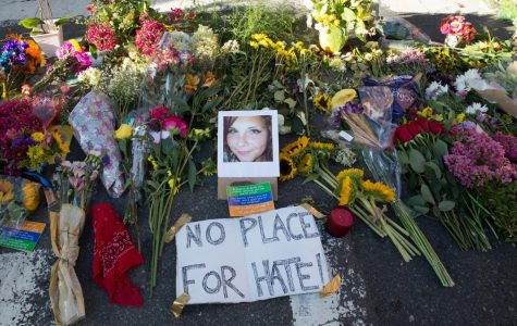 Flowers left at a shrine to show solidarity with Heather Heyer, a victim of the violence in Charlottesville. Heyer was killed after a car crashed into demonstrators protesting a white supremacy rally. Image source:  <a href=