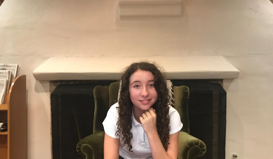 Claire Germano poses for a picture while she sits in the library during homework. Germano is the only senior in the Class of 2018 to be named a National Merit Scholar Semifinalist.