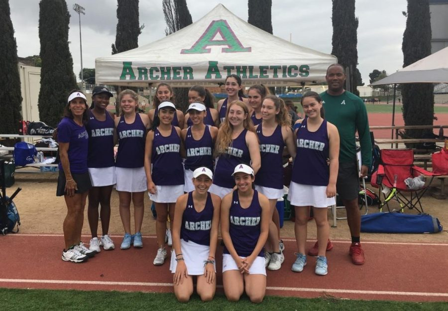 The Archer varsity tennis team poses before a game. The team is currently undefeated and most recently beat Buckley 11-7.