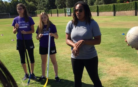 "Danielle LeNoir (right) teaches Emma London '21 and Isa Ionazzi '21 in her freshman fitness class how to play quidditch. ""I just really love being able to connect with the girls,"" LeNoir said."