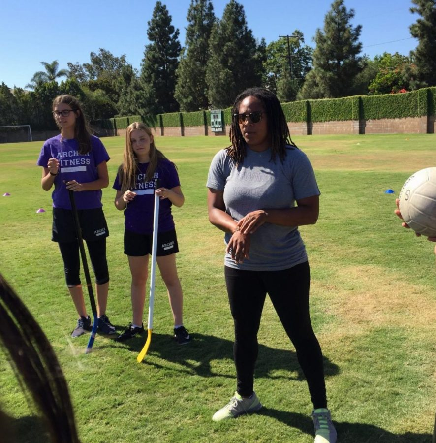 """Danielle LeNoir (right) teaches Emma London '21 and Isa Ionazzi '21 in her freshman fitness class how to play quidditch. """"I just really love being able to connect with the girls,"""" LeNoir said."""