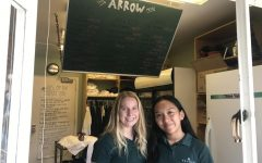 Claire Bardin '18 and Cat Oriel '18 work at The Arrow during X-Block. They help girls purchase snacks with their One Cards and organize the store's food.