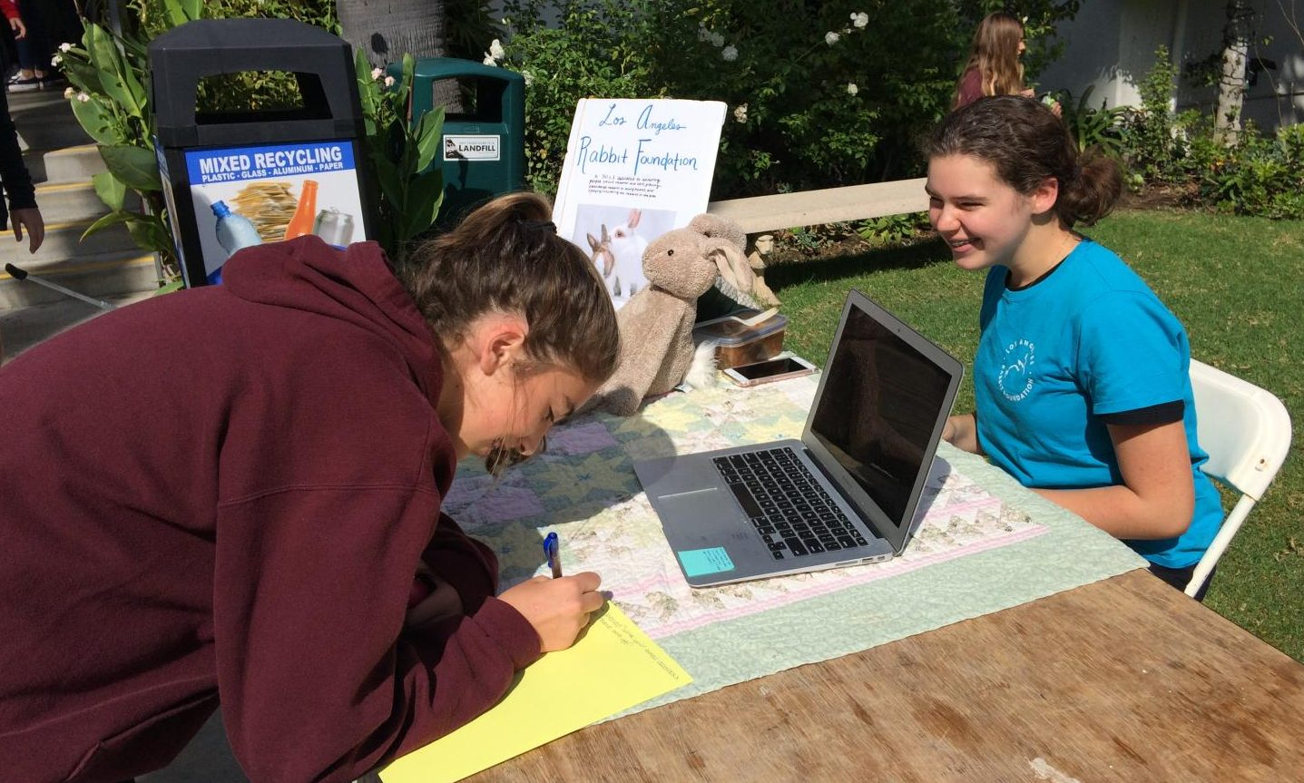 Ruby Horton '21 signs up to volunteer with the Los Angeles Rabbit Foundation. Natalie Grant '19 ran the booth, sharing her passion for the furry creatures with the whole Archer community.