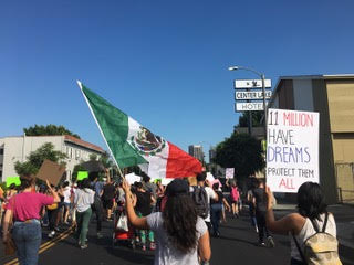 Hundreds of protesters march during a pro-DACA protest.