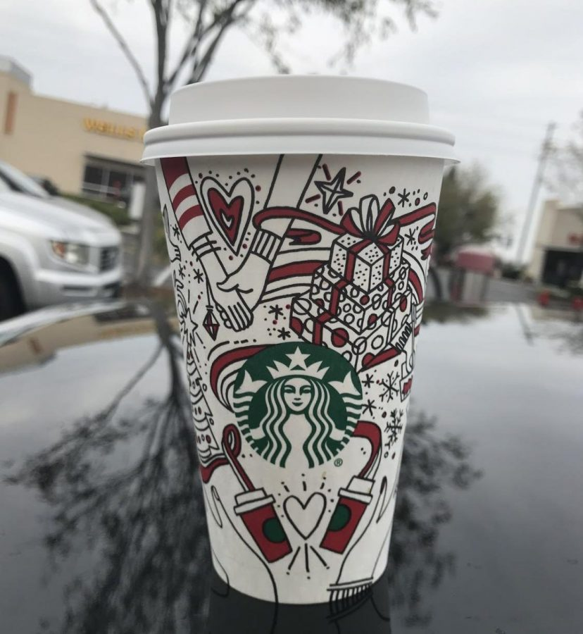 A+delicious+peppermint+mocha+in+Starbucks%E2%80%99+latest+holiday+cup.+The+drink+is+topped+with+whipped+cream+and+chocolate+curls.