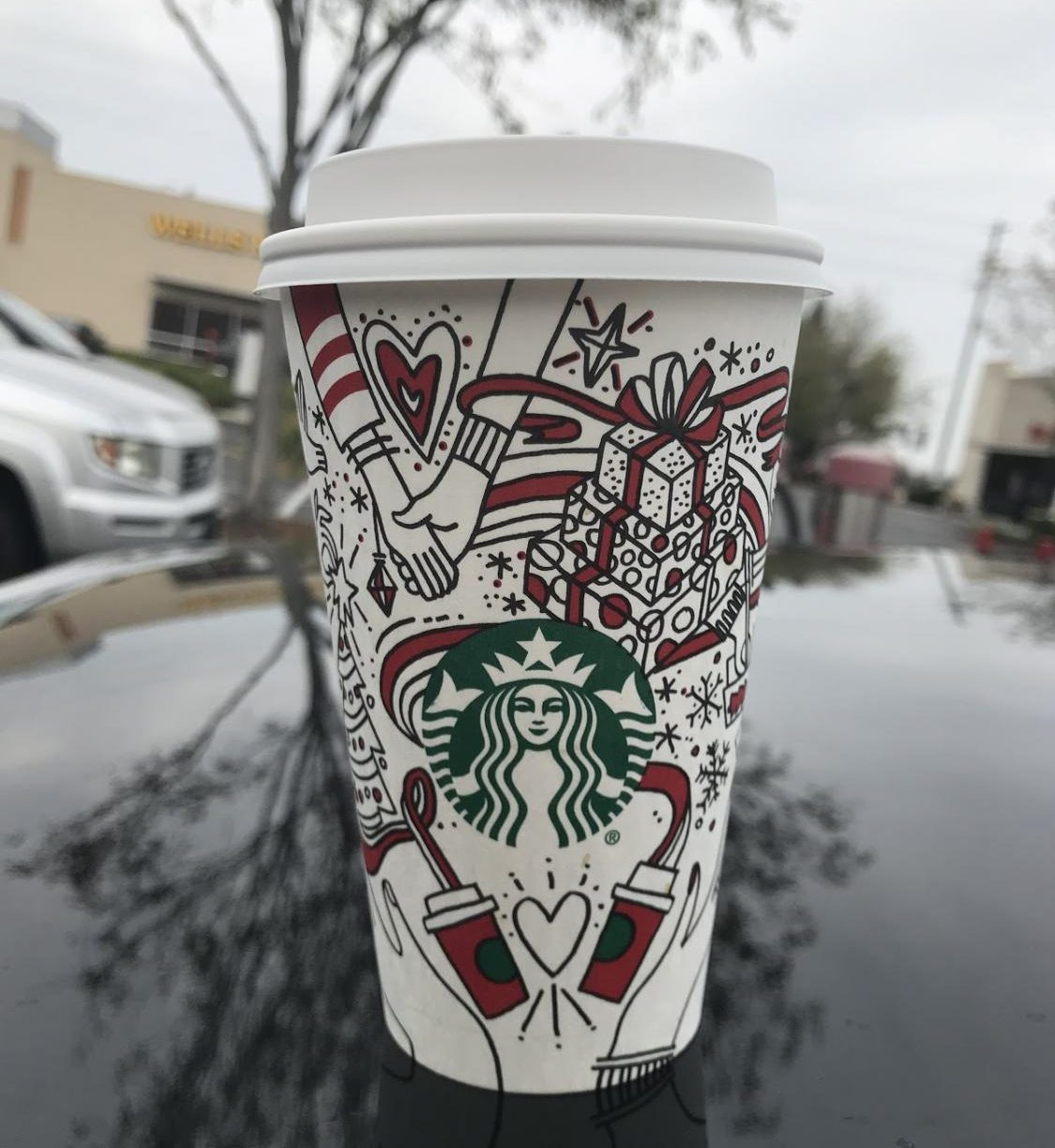 A delicious peppermint mocha in Starbucks' latest holiday cup. The drink is topped with whipped cream and chocolate curls.
