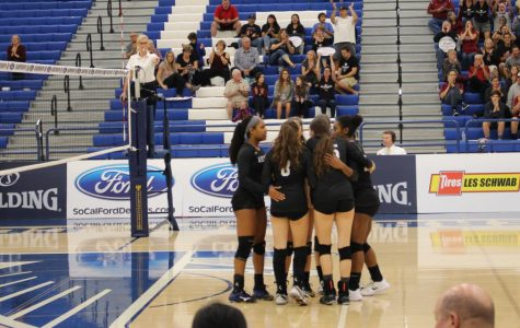 The Archer varsity team huddles between points. The team played against Foothill Tech in CIF-SS Division 7 Finals on Nov. 10 at Cerritos College.