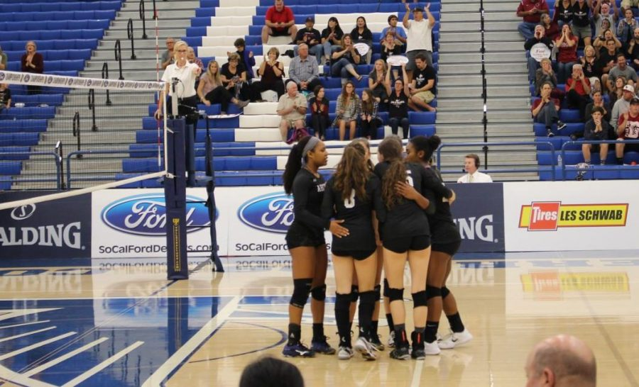 The+Archer+varsity+team+huddles+between+points.+The+team+played+against+Foothill+Tech+in+CIF-SS+Division+7+Finals+on+Nov.+10+at+Cerritos+College.+