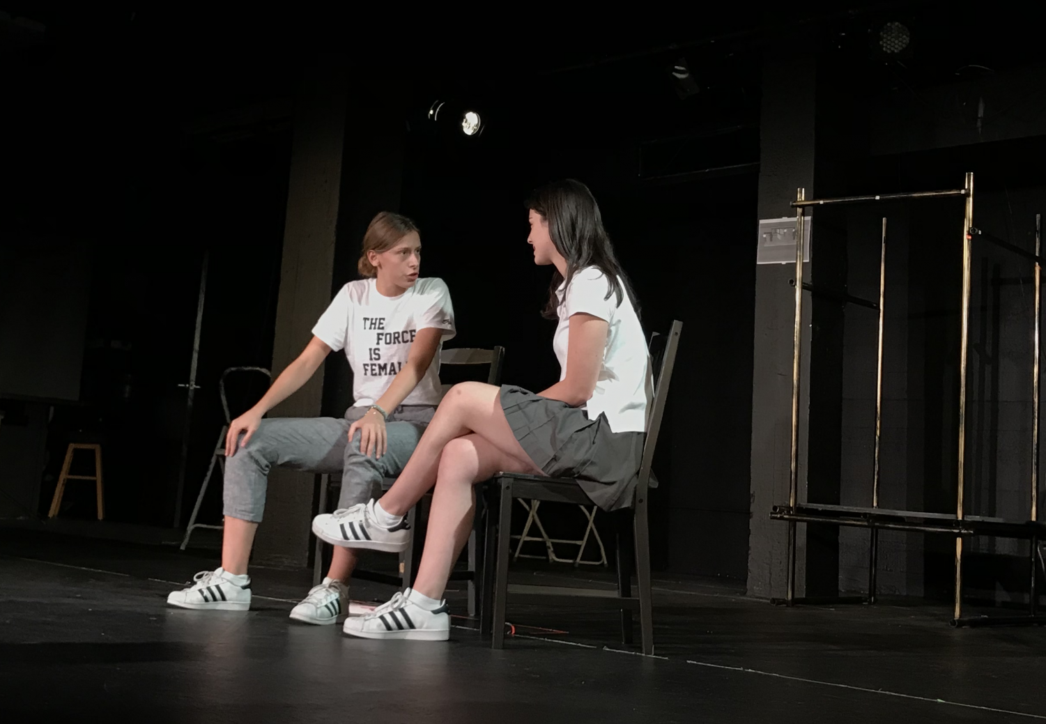 "Maya Winkler '18 and Gracie Abrams '18 perform ""It's Okay Honey"" by Bertha Brown. The scene depicts a mother-daughter conversation about sexuality."