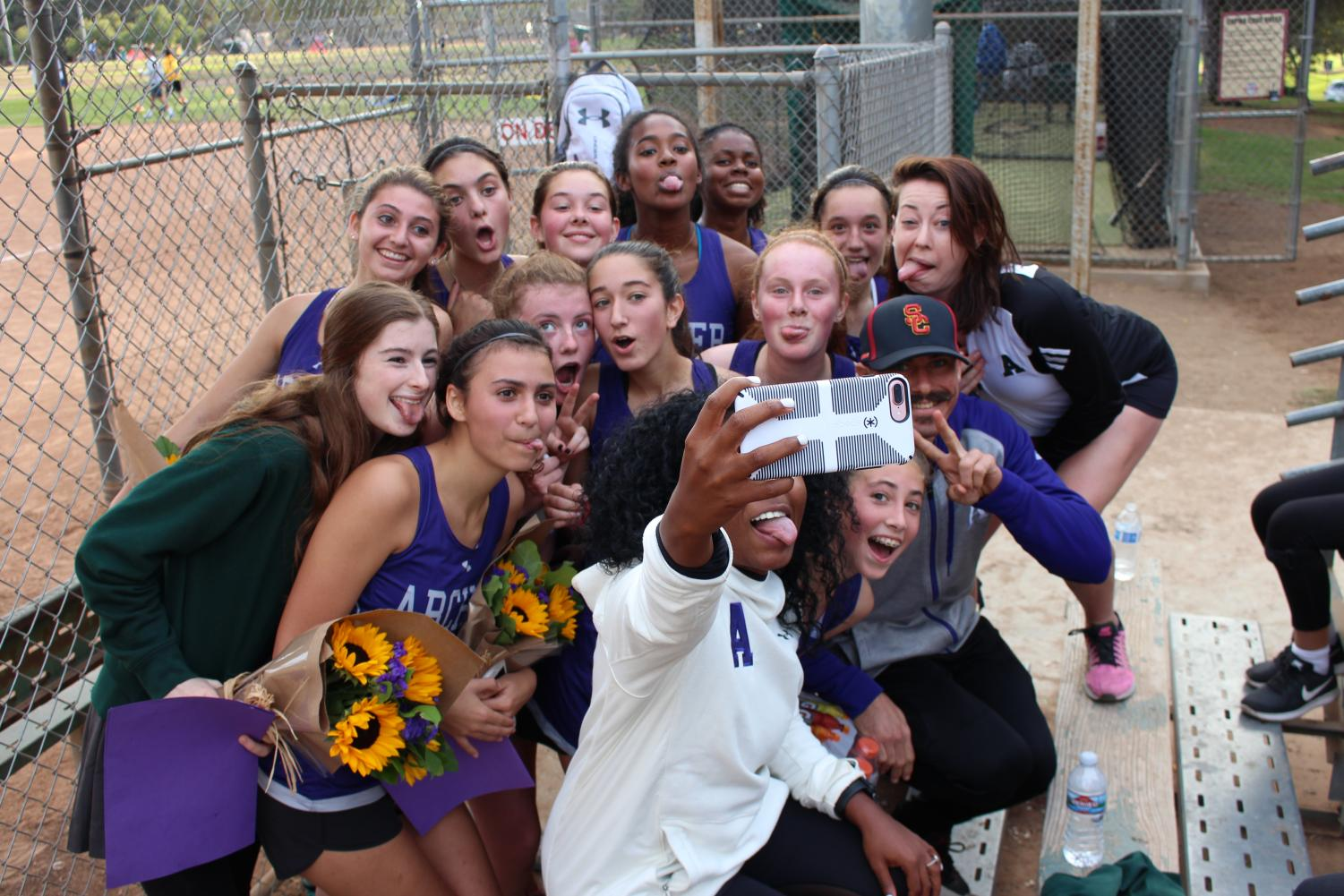 The varisty cross country team poses for a selfie with their coaches. The team celebrated Senior Night on Nov. 1 during League Finals at Cheviot Hills.