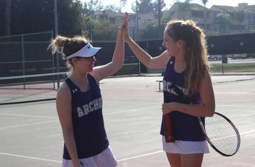 Junior+Zoe+Woolf+and+senior+co-captain+Rachel+Ferrera+congratulate+each+other+during+a+match.+The+pair+played+as+doubles+partners+this+season.+Photo+courtesy+of+Woolf.