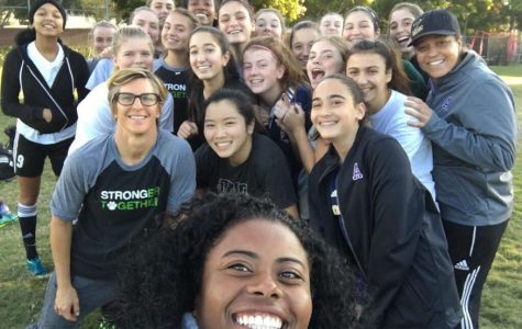 The varsity soccer team poses for a selfie after a practice. The team is working on becoming more cohesive players on the field.