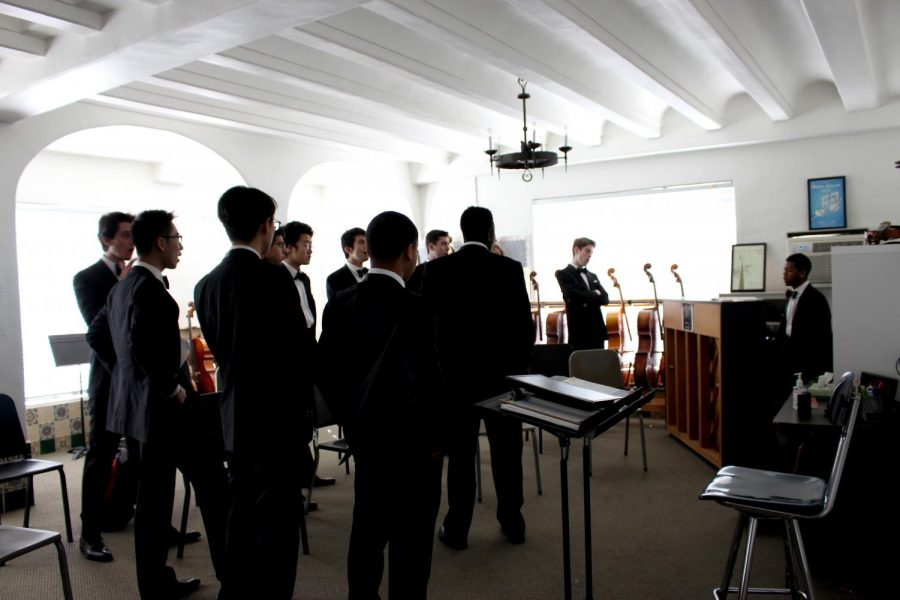 The Kroks warm up their voices in Archer's orchestra room before their performance on Jan. 12. The Kroks originated in Harvard's Hasty Pudding Club, founded in 1770.
