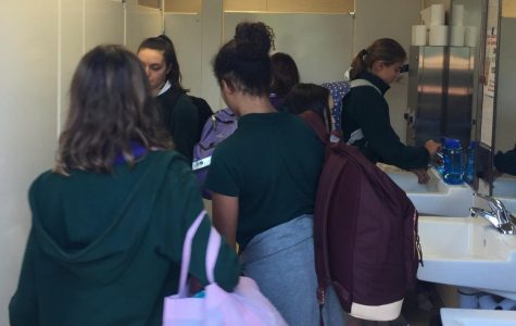 Students navigate Classroom Village bathrooms