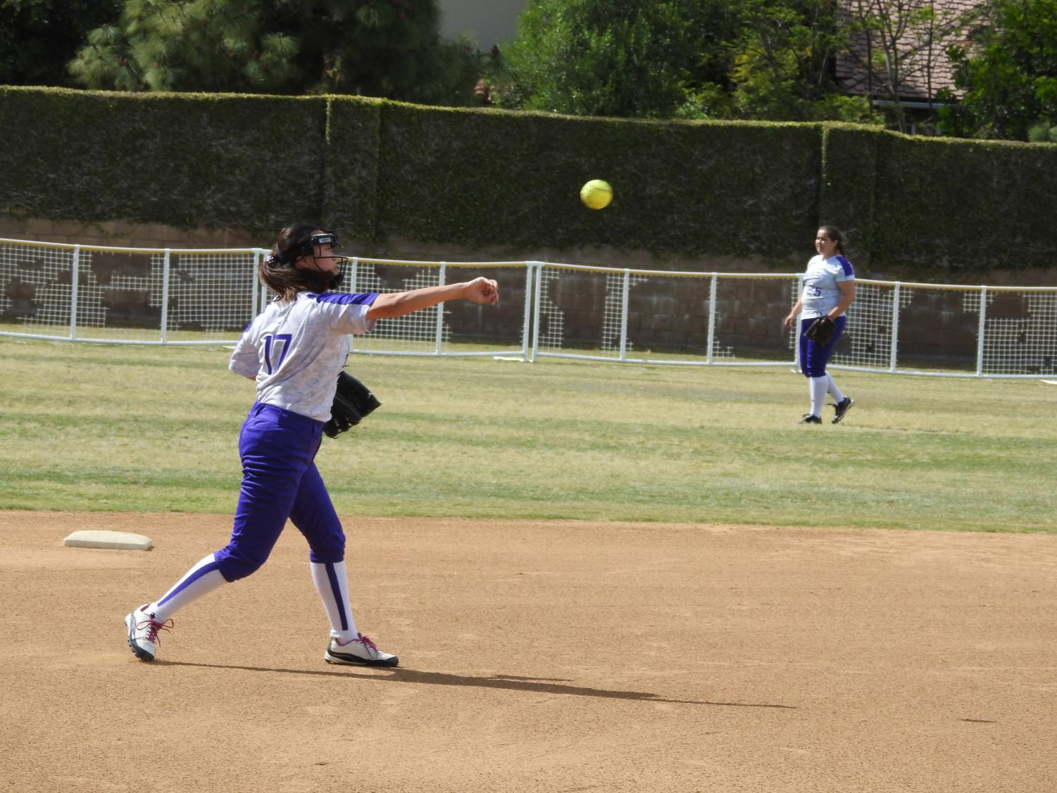 Junior Michele Chung and senior Josie Euyoque-Garcia warm up. The photo was taken on the Archer softball field last year before construction began. Image courtesy of Garcia-Euyoque.