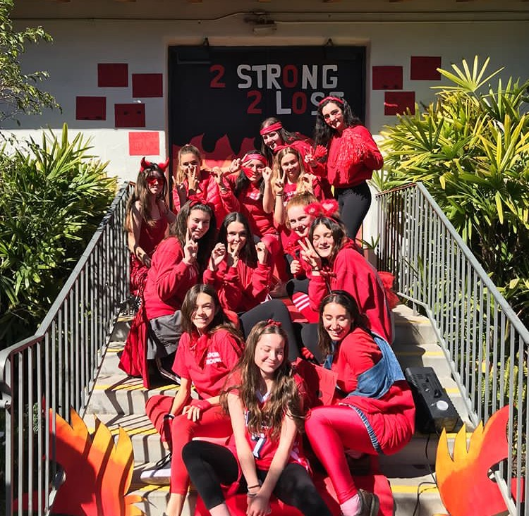 Members+of+the+sophomore+class%2C+who+had+the+color+red%2C+pose+for+a+photo+in+front+of+their+door.+They+earned+12+spirit+points+during+the+event.+Photo+courtesy+of+Emma+Appolverich.+