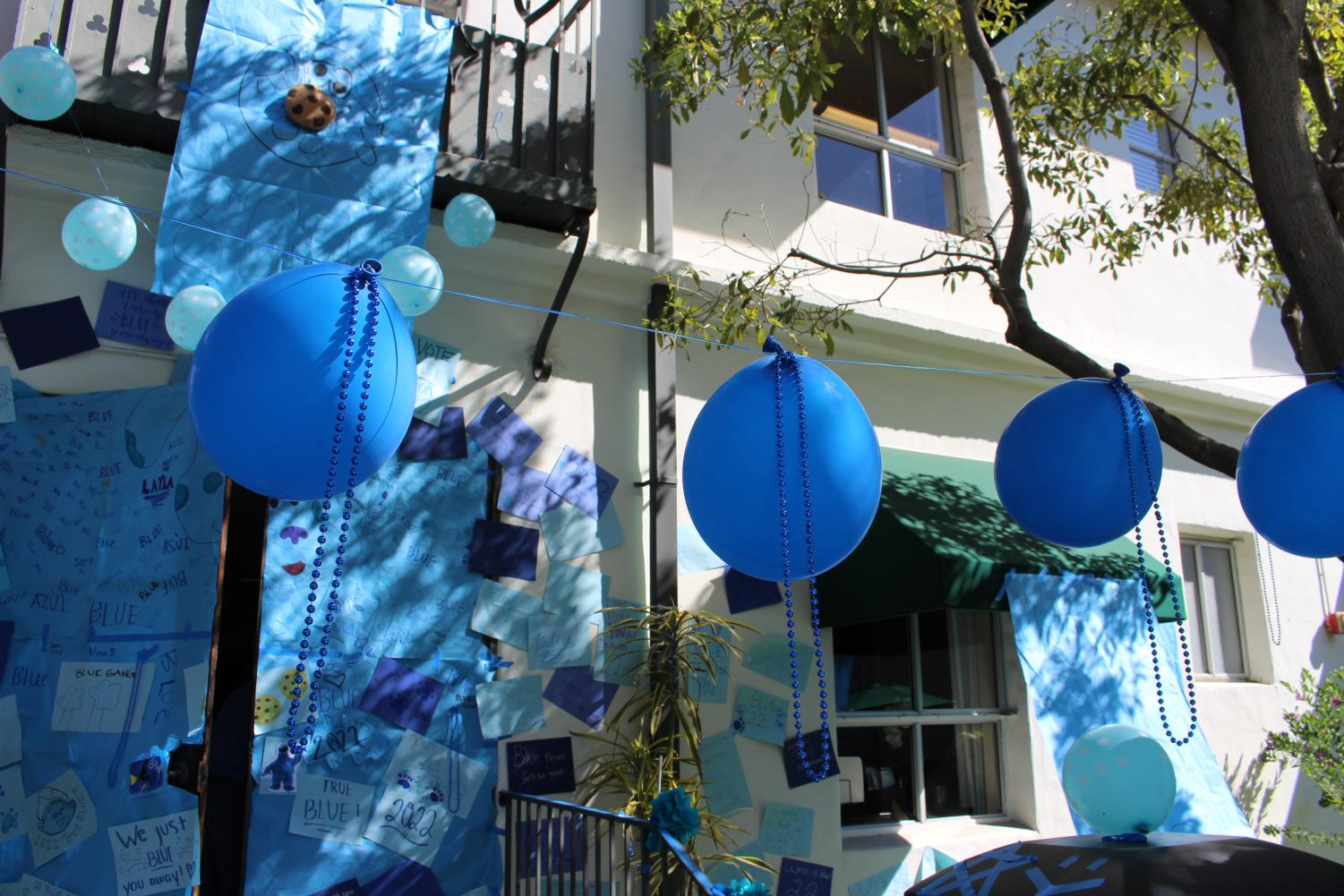The+eighth+grade+class+was+assigned+the+color+blue.+They+decorated+their+door+with+blue+balloons%2C+necklaces+and+posters.