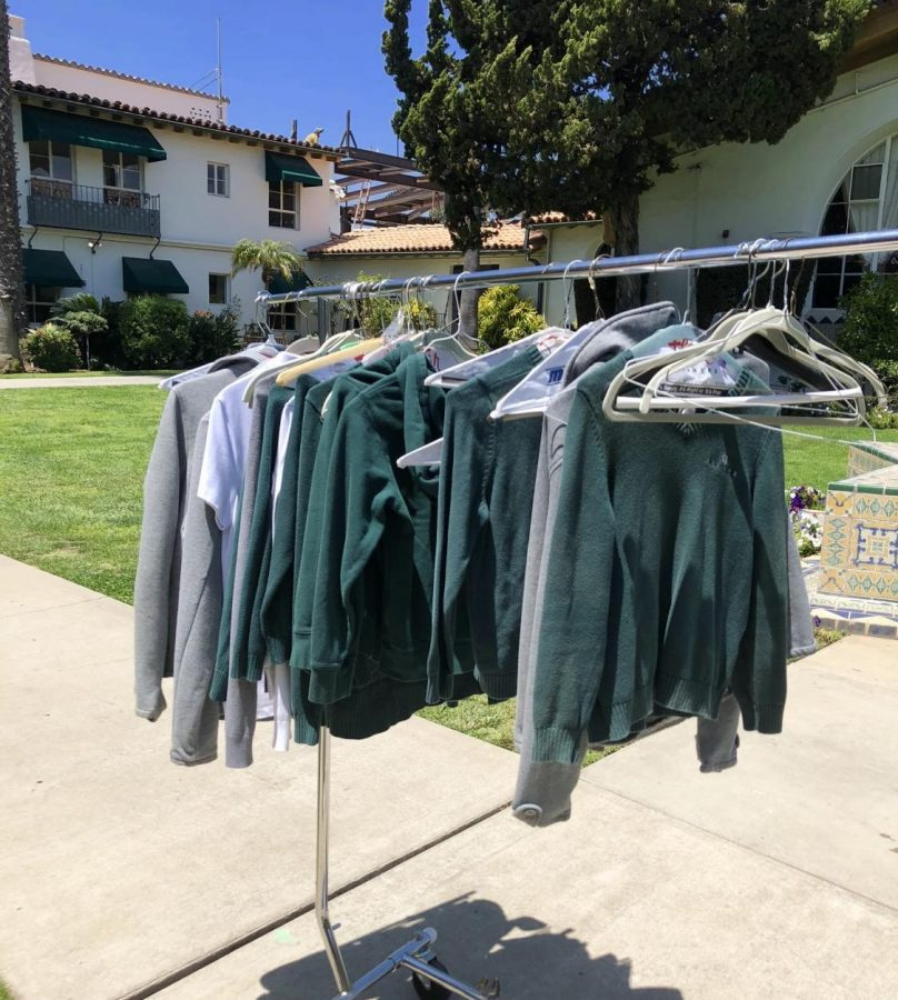 A rack of Archer uniforms, which people donated for an Archer clothing drive that I co-organized earlier this month. The clothes are primarily green, white, black and gray.