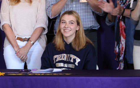 Locke Luhnow '18 smiles after signing her National Letter of Intent. Luhnow is Archer's second ever volleyball recruit.